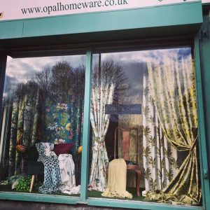 Photograph of Opal shop front in Church Street with curtains and material