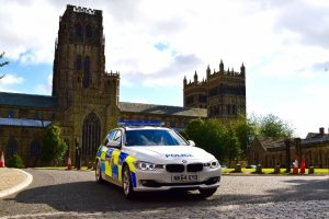 Photograph of police car outside Durham Cathedral