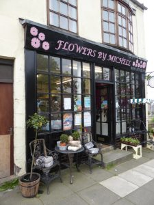 Photograph of flowers by Michell shop front in Church Street
