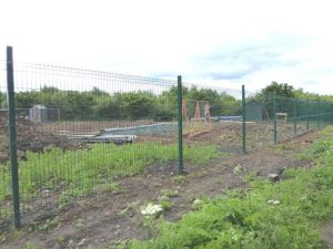Photographs of Quarrington Hill allotments behind a fence