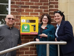 Councillors and Nicola Dodsworth outside Village Hall defib
