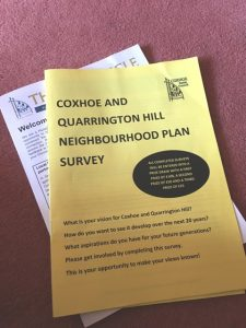 Photograph of a paper copy of the neighbourhood planning household survey an copy of the Chtronicle