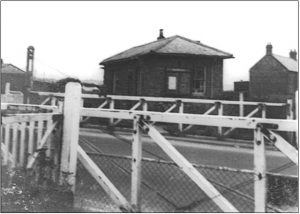 Historical photograph showing Coxhoe Clarence railway crossing with station building and gates