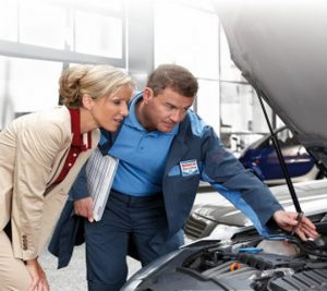Photo of mechanic and customer