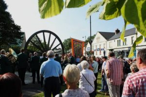 Photo of the Pit Wheel on Gala Day. It involved people in the foreground looking towards the pitwheel.