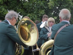 Photograph of brassband paying enthusiastically
