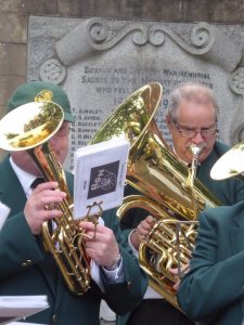 Photograph of brass section playing