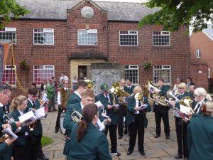 Photograph of band preparing to play on gala day