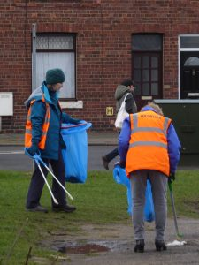 Photograph of volunteer litter pickers working hard at their job