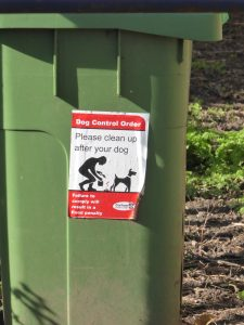 Photograph of clean up after your dog sticker on bin