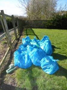 Photograph of volunteer litter pickers collected litter bag at end of event