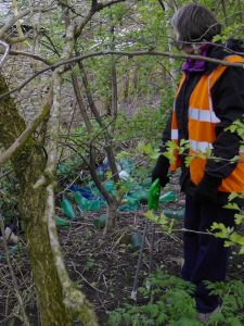 Photograph of volunteers at work picking up rubbish