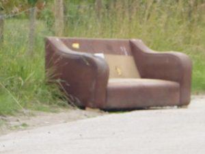 Photograph of dumpted sofa close to tcouncil tip