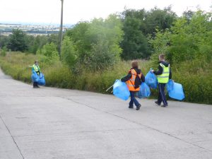 Photograph of volunteer litter pickers nearing end