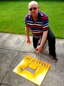 Photograph showing Councillor Dunn with Dog fouling stencil