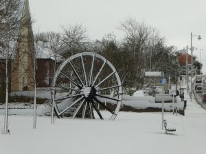 photograph of village green in the snow