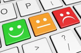 Decorative image showing happy and sad faces on a keyboard