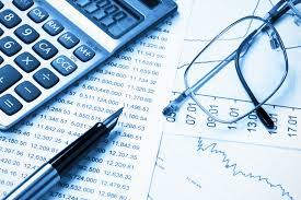 Decorative photo of spreadsheet, calculator, pen and glasses