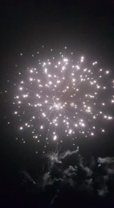 Image of fireworks going off shining lights
