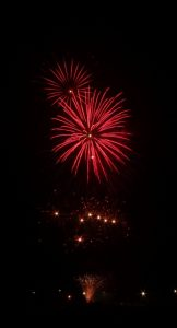 Image of fireworks going off red burst and dots