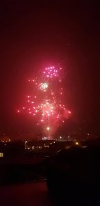 Image of reddish fireworks going off