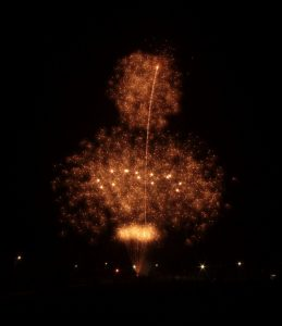 Image of orangeish fireworks going off