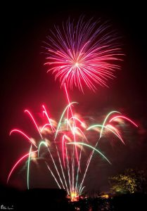 Image of fireworks going off red and white