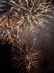 Image of fireworks going off ;eaving the night colourful