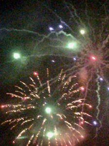 Image of fireworks going off like flares