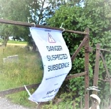 Photograph of sign saying Danger suspected subsidence