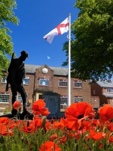 Photograph of Coxhoe Village Hall and Poppies
