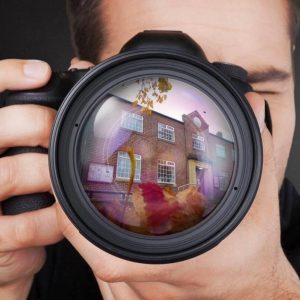 Photograph of village hall reflected on camera lens February 2020. The village hall is shown in the autumn