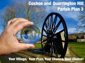 Photograph of coxhoe parish plan adver showing pitwheel through a crystal ball. It incorporates the words Coxhoe Na Quarrington Hill Parish Plan 3, Your Village, Your chance Your Choice.
