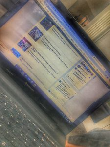 Photograph of blurred computer screen, showing Parish Council home page January 2020