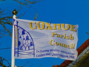 Photograph of corporate flag ouside village hall