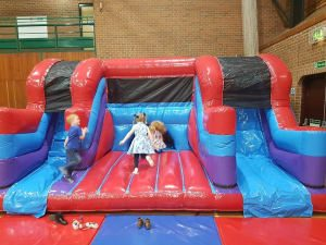 Photograph of children on a bouncy castle