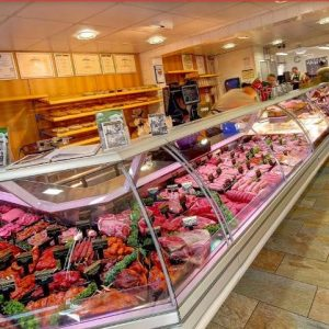A photograph of the counter in Coates butchers showing a wide range of meats and pastries, open during lockdown