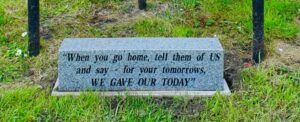 Photograph of remembrance stone at base of Tommies interpretation board in Quarrington Hill. contains the words 'When you go home, tell them of us and say - for your tomorrows, we gave our today'