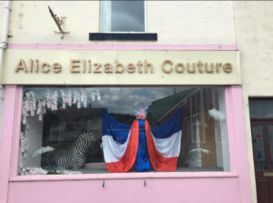 Photograph of Shop front with red white and blue wedding dress