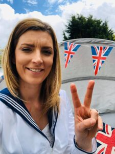 Photograph of sailor lady giving v for Victory sign