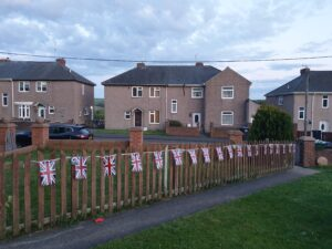 Photograph of fantastic string of bunting on fence