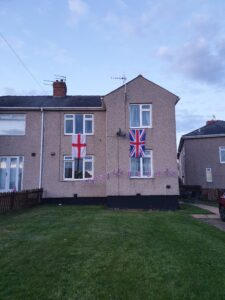 Photograph of flags on house on estate
