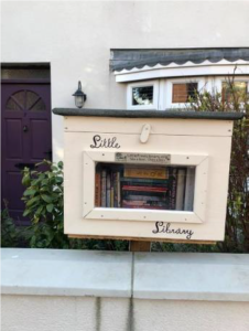 Photograph showing the Little Library situated outside of 7 Linden Terrace Coxhoe