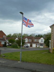 Photograph of flag flying in street