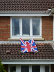 Photograph of flag flying out of window