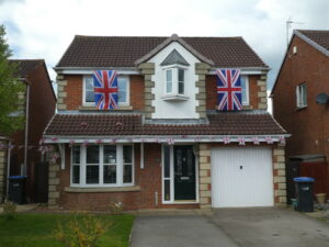 Photograph of House with flags on estate
