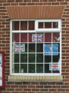 Photograph of flags in Parish Council Office window