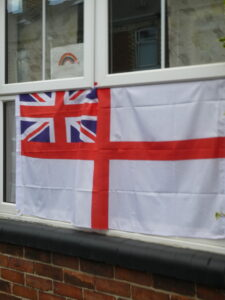 Photograph of flag in window