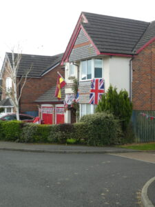 Photograph of different VE Day flags on house