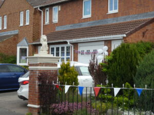 Photograph of bunting on a house in Featherstone Estate